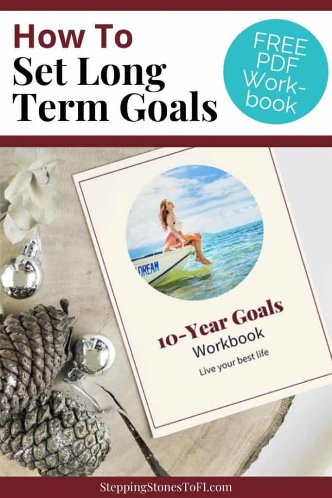"""Long Pinterest image of a workbook on rustic wooden side table with festive pine cone and silver ornaments with text """"10-Year Goals Workbook - Live your best life"""""""