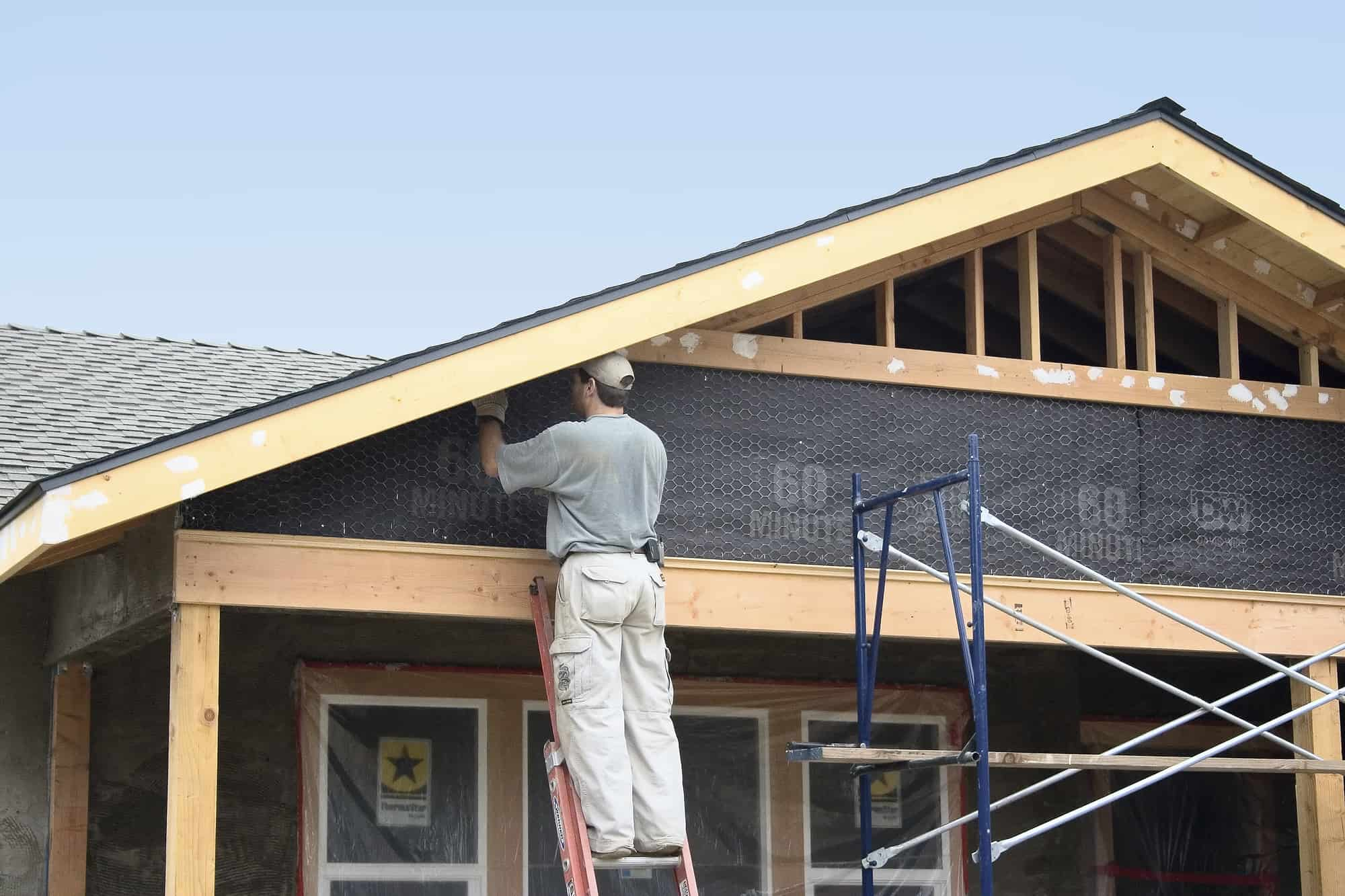 Homeowner working on a home remodel project for house flipping real estate investing