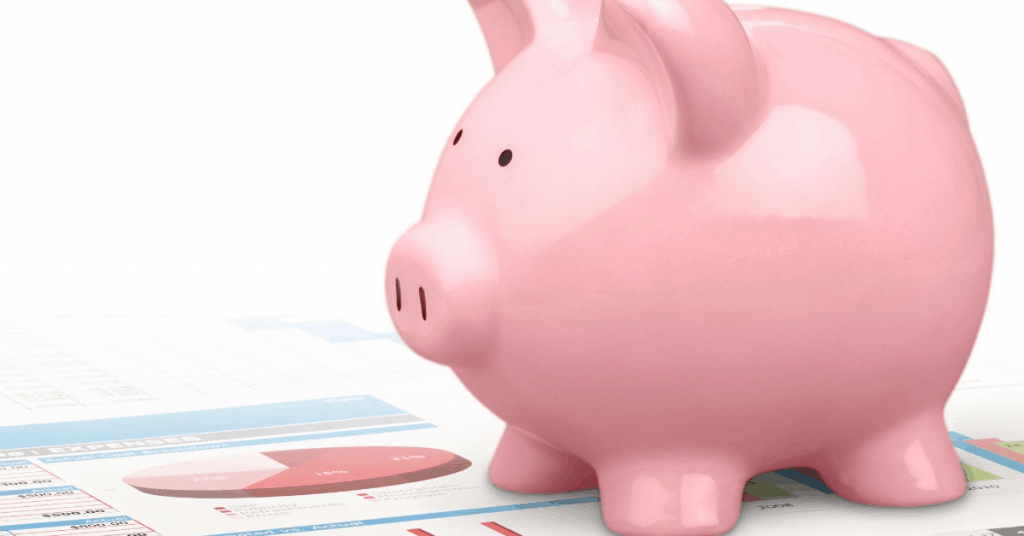 Piggy bank sitting on financial paperwork