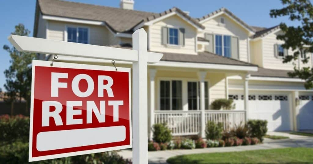 Image of a nice house with a for rent sign out front - how I bought my first rental property