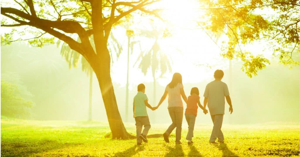 Family walking together - how to pick the right life insurance to protect your family