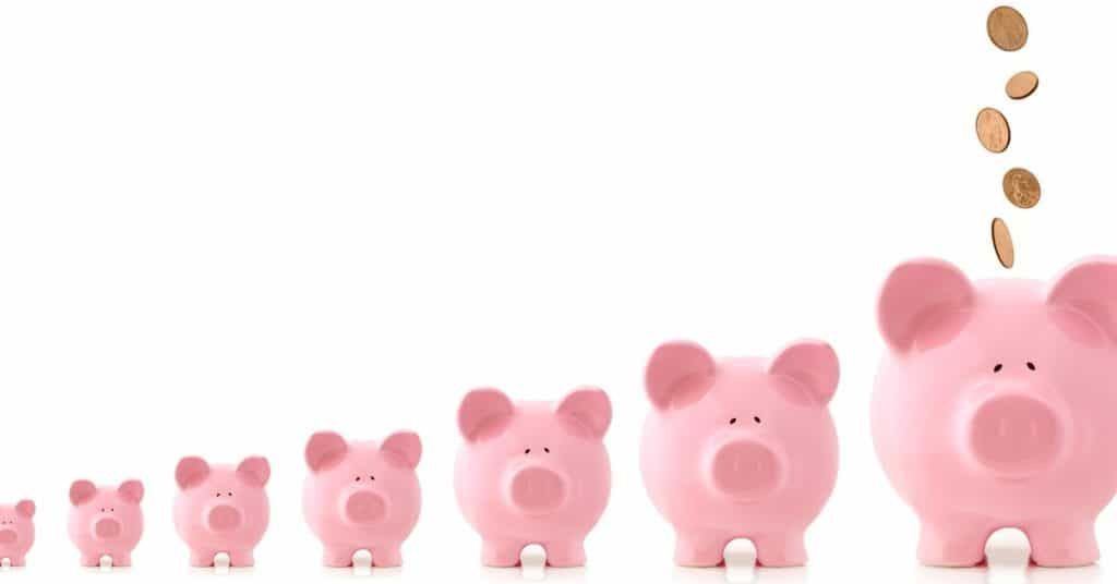 Line of piggy banks getting progressively bigger in size, representing retirement savings and compound interest.