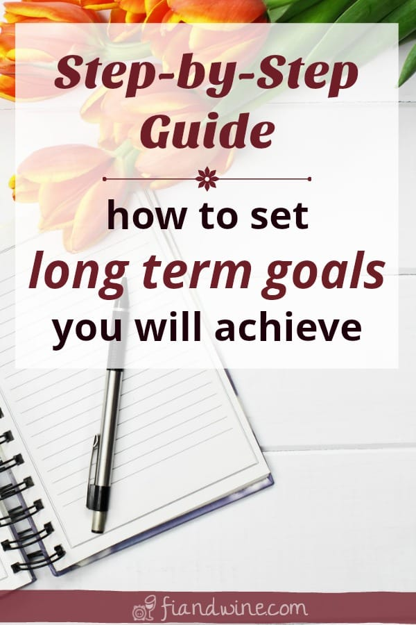 "Journal and beautiful tulips on a desk with text overlay ""Step-by-Step Guide to set your long term goals"""