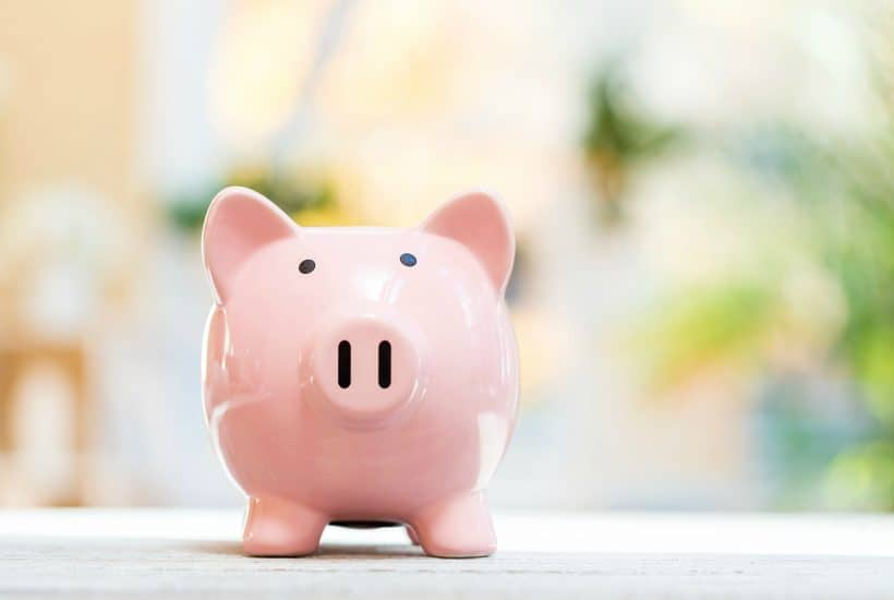 Piggy bank on a bright interior room background