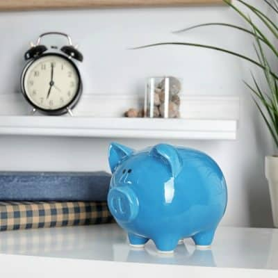Cute piggy bank on table indoors. Stylish interior