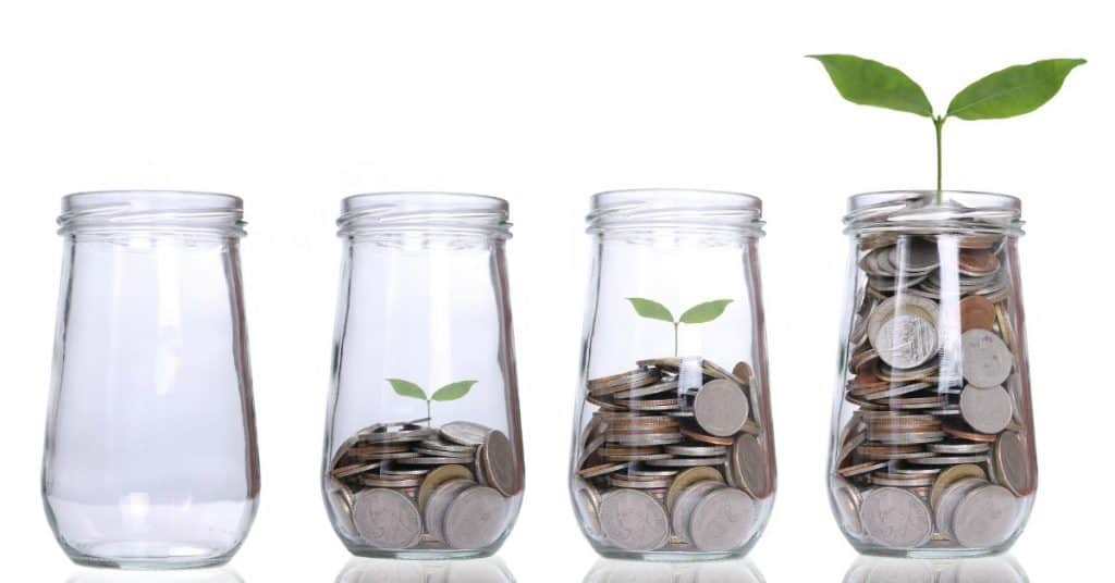 4 jars lined up, each with more coins inside, the last with plant growing - how you can save just $50 a month