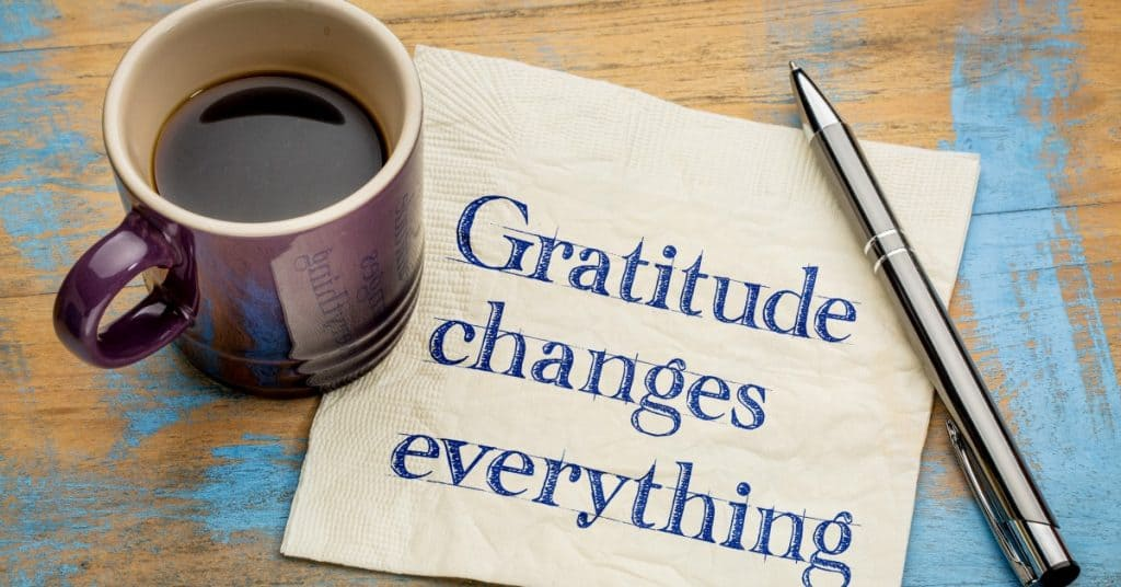 Gratitude changes everything - handwriting on a napkin with a cup of espresso coffee