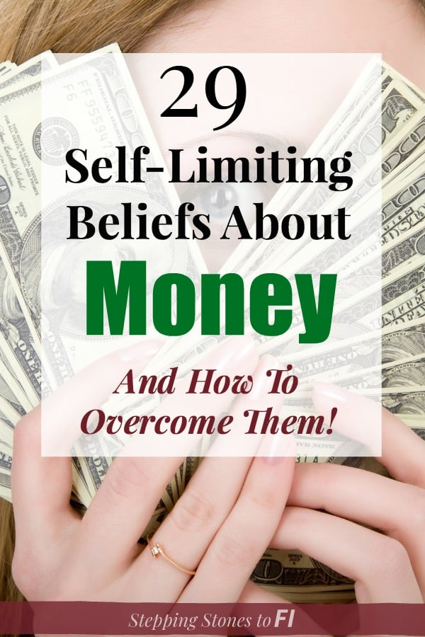 """Closeup of woman hiding behind a handful of $100 bills with text """"29 Self limiting beliefs about money and how to overcome them"""""""