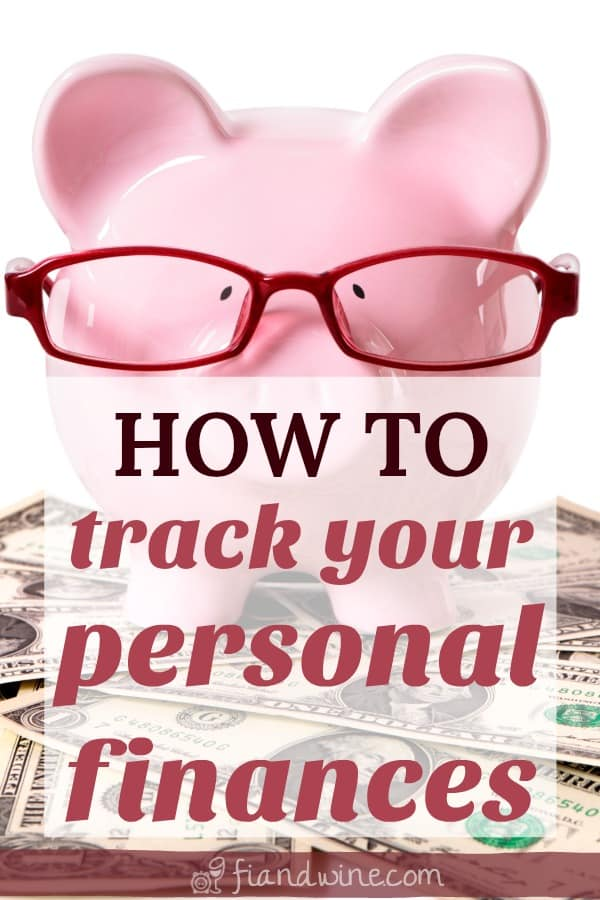 """Piggy bank with reading glasses sitting on a pile of dollar bills with Text """"How to track your personal finances"""""""